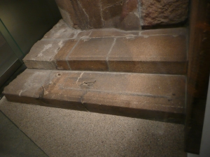 """The heat waves radiating from the bomb site were sufficient enough to melt roofs or cook stone. Where there was an impediment, a """"shadow"""" was cast in material behind it. In this case, a person was sitting on these steps and received the force of the heat that damaged the steps behind."""
